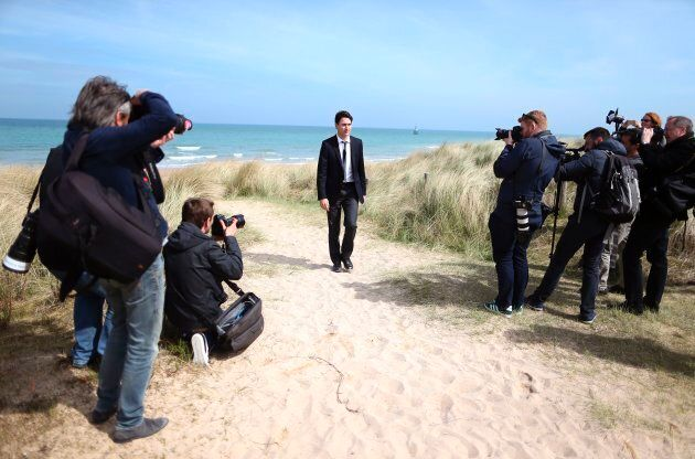 Press photographers gather as Justin Trudeau leaves Juno beach on April 10, 2017 in Courseulles-sur-Mer,...