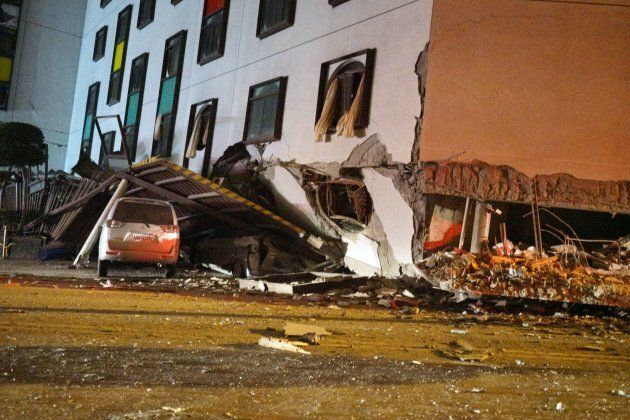A damaged vehicle stands in rubble outside the Marshal Hotel in Hualien, eastern Taiwan on Feb. 7, 2018,...