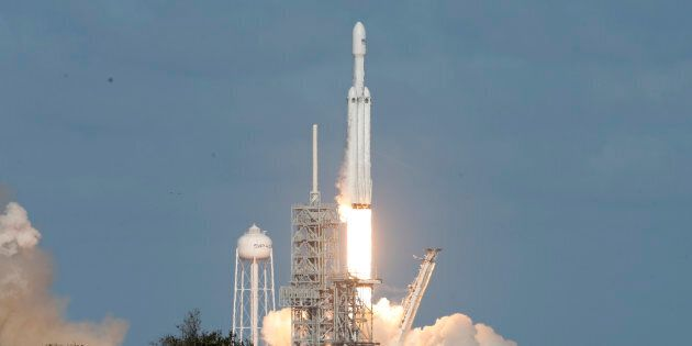 A SpaceX Falcon Heavy rocket lifts off from historic launch pad 39-A at the Kennedy Space Center in Cape...