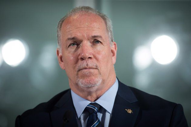 British Columbia Premier John Horgan listens during a news conference in Vancouver on Feb. 2,