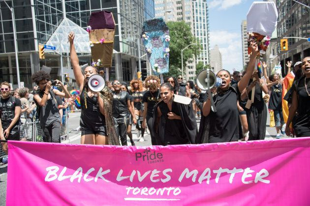 Black Lives Matter Toronto marching at the Toronto Pride Parade, where they would later stage a sit-in,...