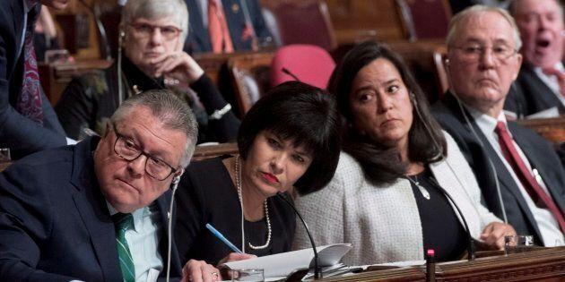 Ministers Ralph Goodale, Ginette Petitpas Taylor, Jody Wilson-Raybould and MP Bill Blair listen during...