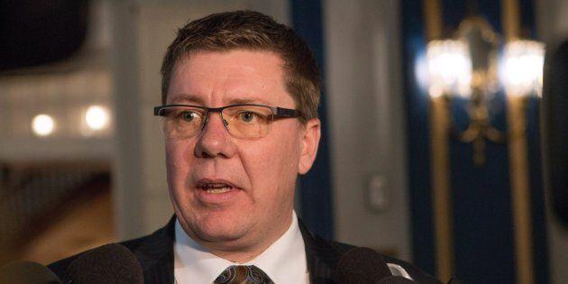 Saskatchewan premier Scott Moe speaks with reporters following the swearing-in ceremony in Regina on...