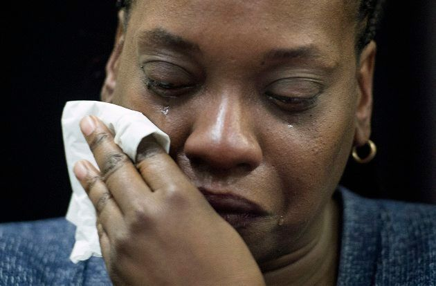 Johanne Coriolan, a family member of Pierre Coriolan, cries during a news conference in Montreal on Feb....