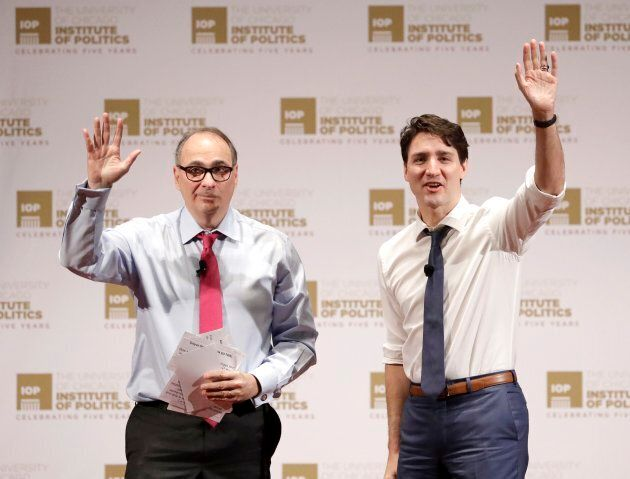 David Axelrod and Justin Trudeau acknowledge the audience's applause after Trudeau's appearance at the...