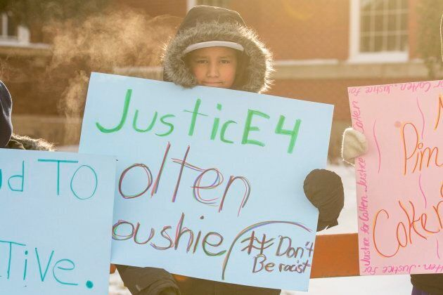Grade 7 and 8 students from the Piyesiw Awasis School on the Thunderchild First Nation hold signs outside...