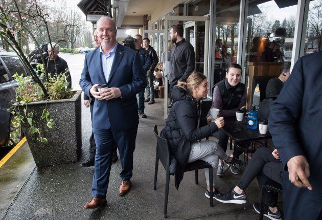 British Columbia Premier John Horgan leaves a coffee shop after announcing changes to the province's...