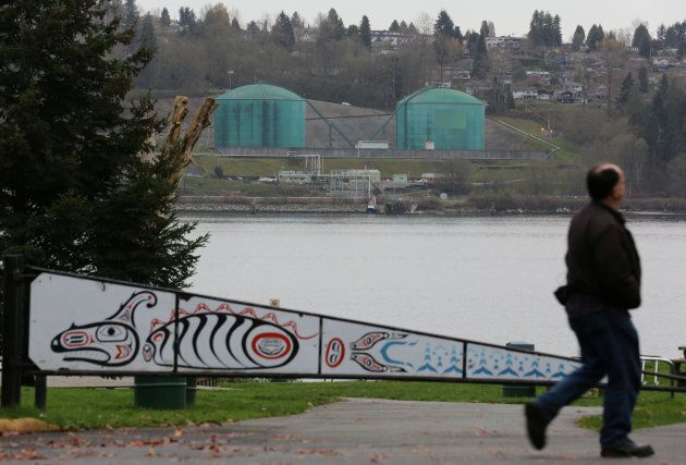 A man walks in Cate's Park, on lands of the Tseil-Waututh Nation across  Burrard Inlet from Kinder Morgan's Westridge Terminal, in North Vancouver, B.C. on Nov. 18, 2016.