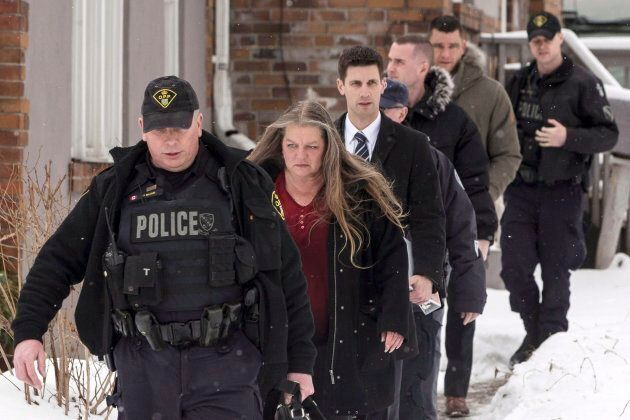 Forensic Anthropologist Professor Kathy Gruspier (second left) is seen on Feb. 8, 2018, with police officers...