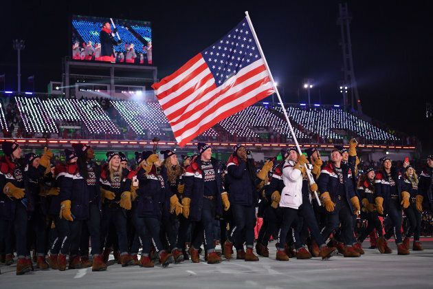 Flag-bearer Erin Hamlin of the United States leads the team during the opening ceremony.
