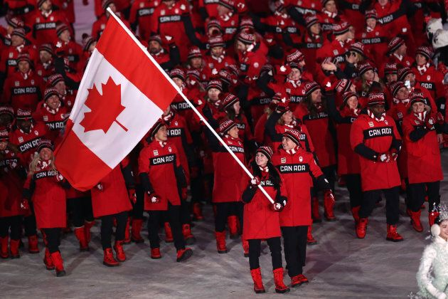 Flag bearers Tessa Virtue and Scott Moir leads Team Canada during the opening ceremony.