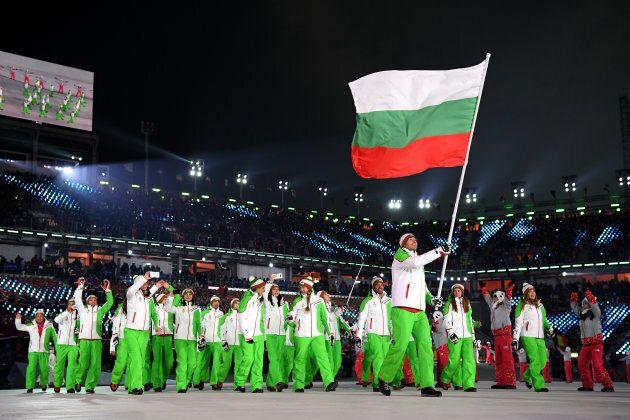 Flag bearer Radoslav Yankov of Bulgaria and teammates enter the stadium during the opening ceremony.