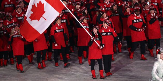 Flag bearers Tessa Virtue and Scott Moir of Canada lead the team during the Opening Ceremony of the PyeongChang...