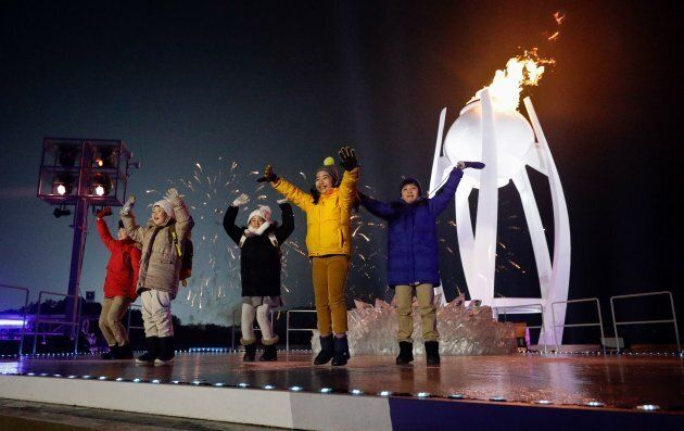 Children perform as the cauldron is lit during the opening ceremony of the PyeongChang 2018 Winter Olympic Games on Feb. 9, 2018.