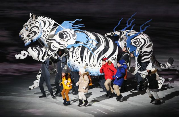 Children are led by a white tiger at the opening ceremony of the PyeongChang 2018 Winter Olympic Games.