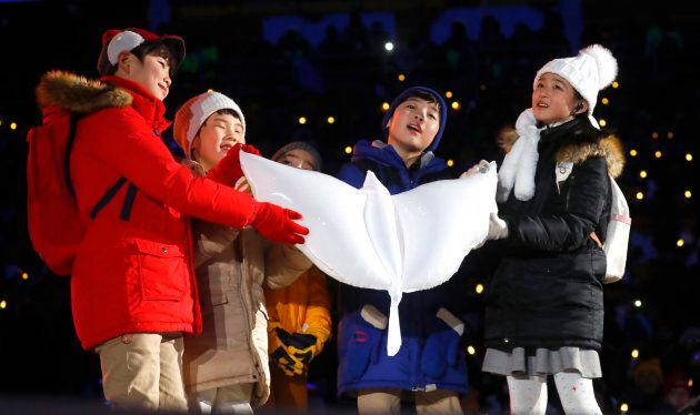 Children release a white dove during the opening ceremony at the PyeongChang 2018 Winter Olympics.