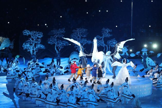 Children are led through a wonderland during the opening ceremony at the 2018 Winter Olympics at PyeongChang Olympic Stadium.