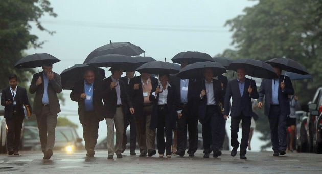 Canada's provincial premiers walk to a morning meeting during their Council of the Federation summit...
