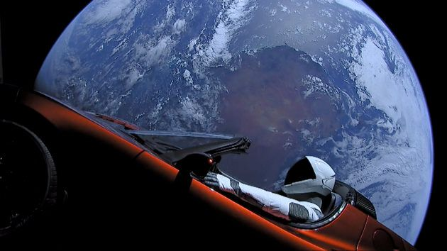 A Tesla roadster launched from the Falcon Heavy rocket with a dummy driver named