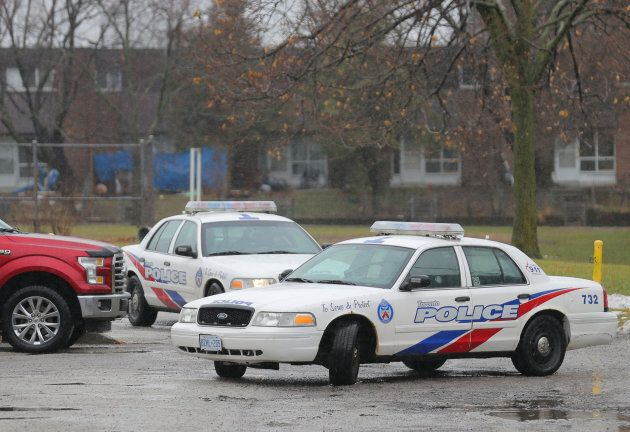 Police officers leave Pauline Johnson Junior Public School, near the site of a reported (and ultimately...