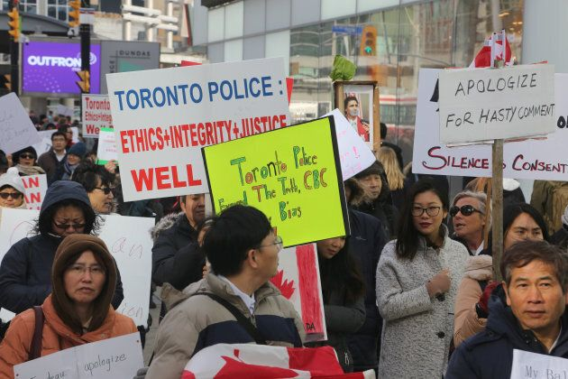 Asian Canadians protested in Toronto, Ont., on Jan. 29, 2018, to demand apologies following the revelation that an 11-year-old Muslim girl's story that an Asian man had cut her hijab while she walked to school was untrue.
