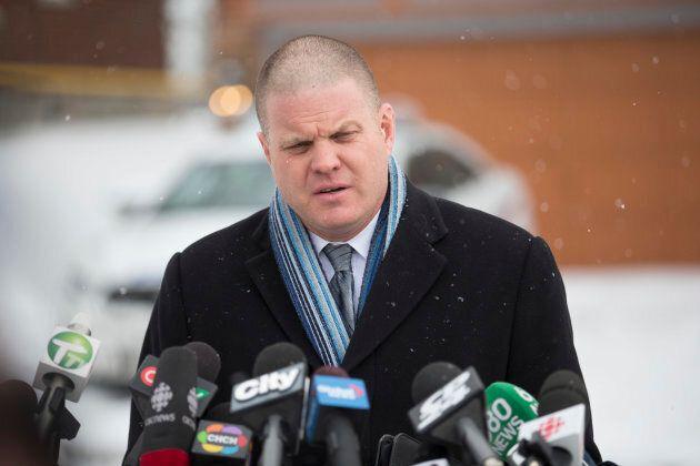 Officer Hank Idsinga speaks to the media at 53 Mallory Cresc. in