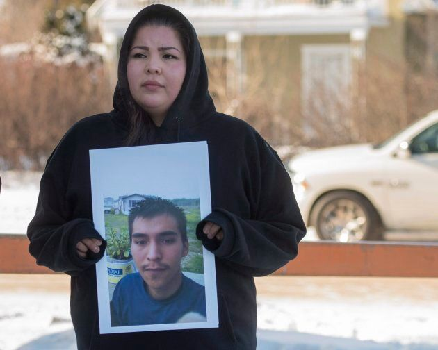 Krissa Baptiste holds a picture of her cousin of Colten Boushie during a recess of closing arguments...