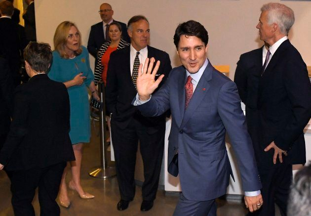 Prime Minister Justin Trudeau waves after speaking in the Air Force One Pavilion at the Ronald Reagan...