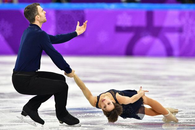 Canada's Meagan Duhamel and Canada's Eric Radford compete in the figure skating team event pair skating...