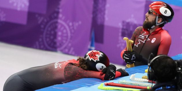 Charles Hamelin, left, consoles Samuel Girard after the finished sixth and fourth respectively in the...
