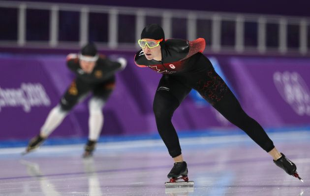 Canada's Ivanie Blondin of Canada, right, competes against Claudia Pechstein of