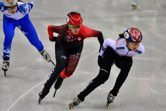 South Korea's Shim Sukhee, right, and Canada's Marianne St Gelais, middle, take part in the women's 3,000-metre
