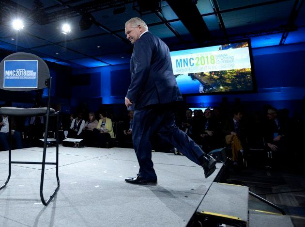 Ontario PC Party leadership candidate Doug Ford walks on stage before participating in a question-and-answer...