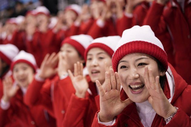 North Korean supporters cheer during the preliminary round of the women's hockey game between Switzerland and the combined Koreas at the 2018 Winter Olympics in Gangneung, South Korea on Feb. 10, 2018.