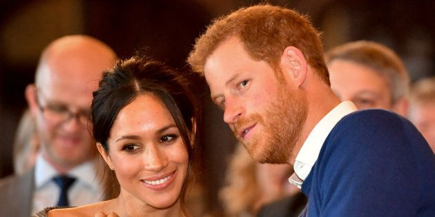 Britain's Prince Harry whispers to Meghan Markle as they watch a dance performance by Jukebox Collective...