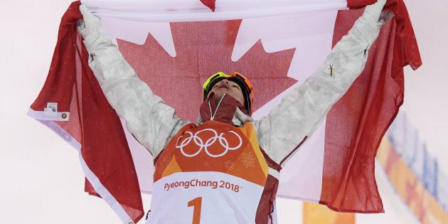 Canada's Mikael Kingsbury of Canada celebrates winning gold in the men's