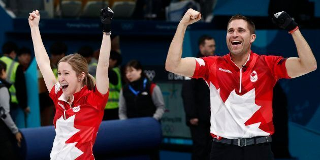 John Morris celebrates with teammate Kaitlyn Lawes of Canada after winning the gold medal against Switzerland...