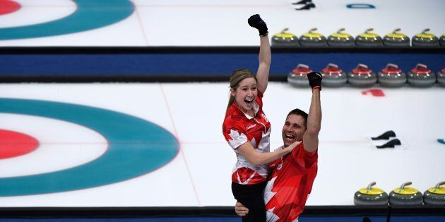 Canada's Kaitlyn Lawes and John Morris celebrate winning the curling mixed doubles gold medal