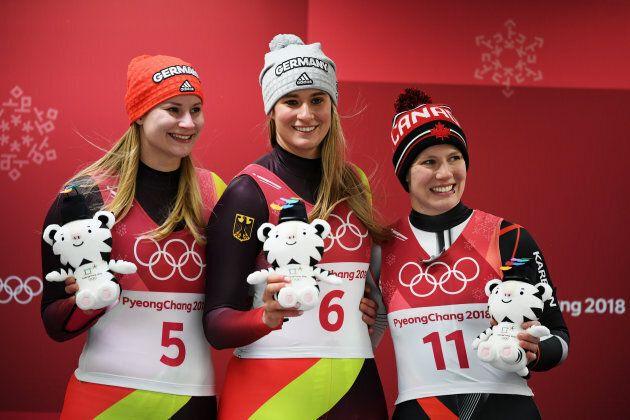Silver medalist Dajana Eitberger of Germany, left, gold medalist Natalie Geisenberger of Germany, middle,...