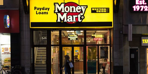 People walking in front of a Money Mart store in