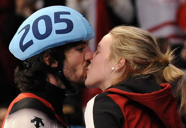 Charles Hamelin kisses his girlfriend and fellow Canadian short-track skater Marianne St-Gelais during...