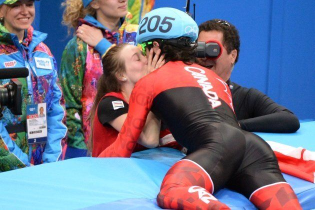 Canada's Charles Hamelin kisses his girlfriend Marianne St-Gelais after winning the gold medal in the...