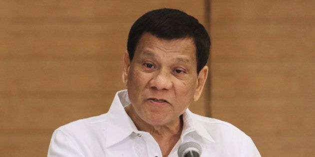 Philippine President Rodrigo Duterte gestures as he speaks during a press conference in Davao City, in...