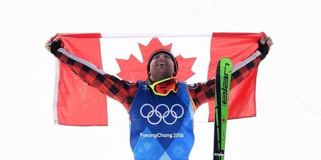 Gold medallist Canada's Brady Leman celebrates during the victory ceremony after the men's ski