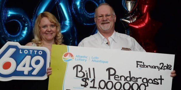 Carrie and Bill Pendergast pose with their novelty cheque after Bill won $1 million in a Lotto 6/49