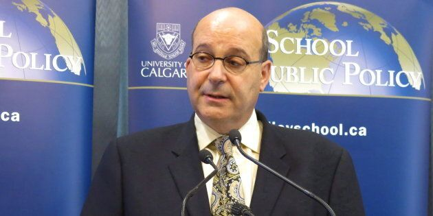 Jack Mintz of the School of Public Policy at the University of Calgary speaks to reporters in Calgary...