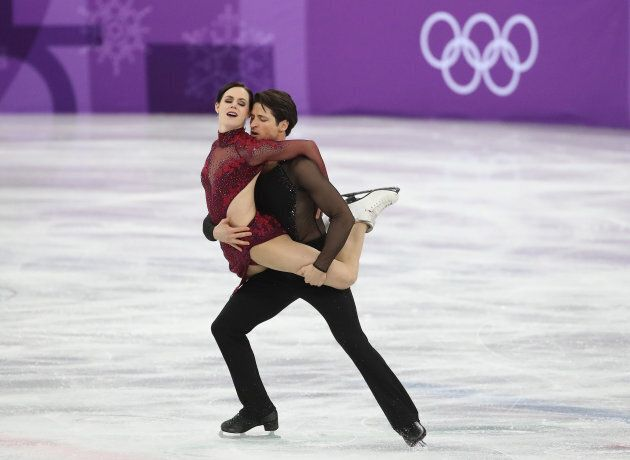 Tessa Virtue and Scott Moir perform their