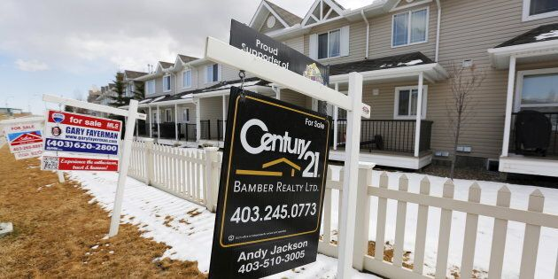 For sale signs line in Calgary, Alta., April 7, 2015. Calgary was among the cities that saw falling house...