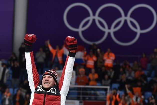 Canada's Ted-Jan Bloemen celebrates on the podium after winning gold in the men's 10,000-metre speed...