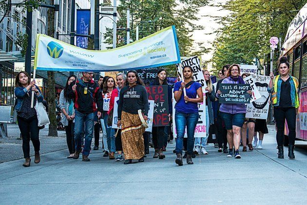 WAVAW Rape Crisis Centre representatives march in